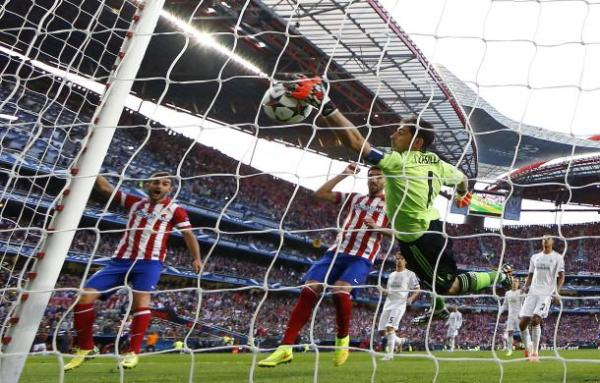 Real Madrid's goalkeeper Casillas fails to save a goal by Atletico Madrid's Godin during their Champions League final soccer match at the Luz Stadium in Lisbon