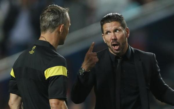 Atletico Madrid's coach Simeone complains to the referee about adding an extra minute after the end of the first half of the extra time during their Champions League final soccer match against Real Madrid at the Luz Stadium in Lisbon
