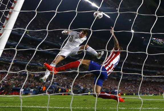 Real Madrid's Bale scores a goal past Atletico Madrid's Alderweireld during their Champions League final soccer match at the Luz Stadium in Lisbon