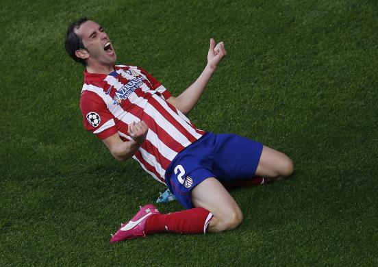 Atletico Madrid's Godin celebrates after scoring a goal against Real Madrid during their Champions League final soccer match at the Luz Stadium in Lisbon