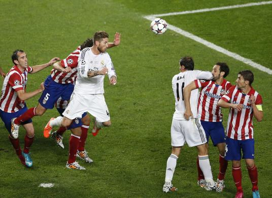Real Madrid's Ramos heads the ball to score a goal against Atletico Madrid during their Champions League final soccer match at the Luz Stadium in Lisbon