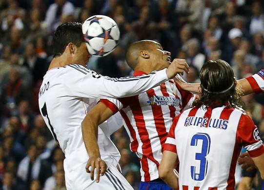 Real Madrid's Ronaldo goes for the ball with Atletico Madrid's Miranda as Luis runs up during their Champions League final soccer match at Luz stadium in Lisbon