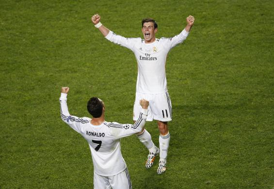 Real Madrid's Bale celebrates with his team mate Ronaldo at the end of their Champions League final soccer match against Atletico Madrid at the Luz Stadium in Lisbon