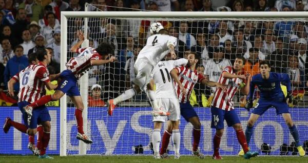 Real Madrid's Ramos shoots and scores the first goal for the team during their Champions League final soccer match against Atletico Madrid at the Luz Stadium in Lisbon