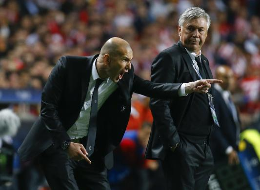 Real Madrid's coach Ancelotti watches his assistant Zidane shout at their players during their Champions League final soccer match against Atletico Madrid at Luz stadium in Lisbon